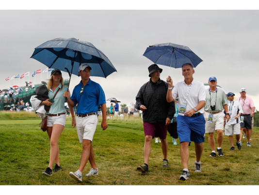 OAKMONT, PA - JUNE 16: Fans take cover during an inclement weather delay in the first round of the U.S. Open at Oakmont Country Club on June 16, 2016 in Oakmont, Pennsylvania. (Photo by Christian Petersen/Getty Images)